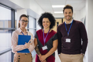 Three smiling teachers
